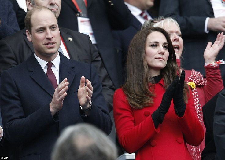 Lady in red: Kate looked a pictured of elegance in a red coat as she cheered on Wales agai...