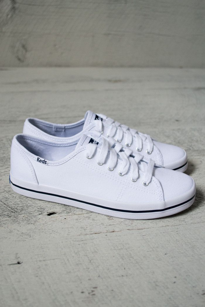 Traditional Keds tennis shoes made with canvas material. Laced up with laces included. Perfect for outdoors and indoors.