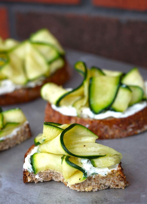 With zucchinis making an appearance in markets, gardens, and grocery stores around the country this season, we can't think of a more delectable appetizer than these Zucchini Crostini. #zucchini #crostini #recipe