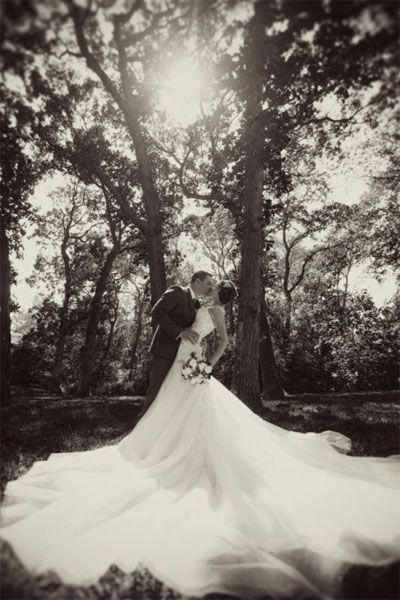 """Why We Love It: An incredible shot of an incredible dress!  Why You Love It: ""The word is 'WOW!' This is awesome!"" —Rachel B. ""The black and white makes this photo timeless. Just beautiful."" —Jaclyn S. ""The dress is laid out perfectly with a great pose — beautiful!"" —Tami W. ""So elegant!"" —Emily M."""