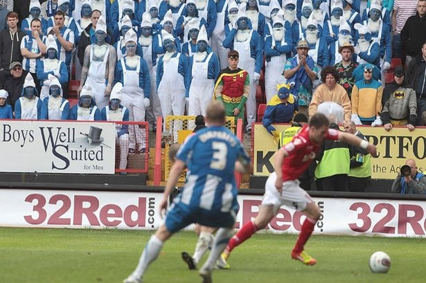Away from gnome: Hartlepool football fans watching the game at Charlton #hufc #smurfs #strumpf