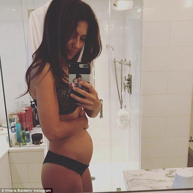 Glowing: Pregnant Hilaria Baldwin showed off her growing baby in a mirror selfie she shared to her Instagram on Friday