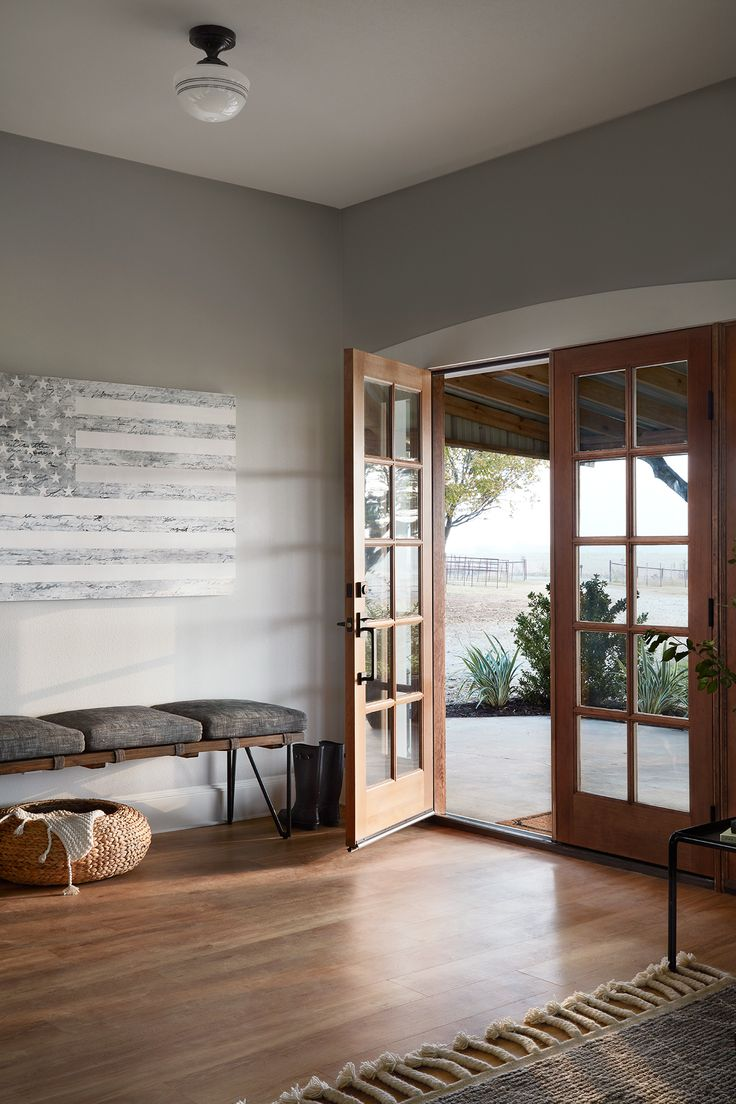 The entry to this home was designed to be warm and welcoming. With the color of the walls and all the natural light coming in through those big french doors, I knew that this area of the home would be plenty bright.