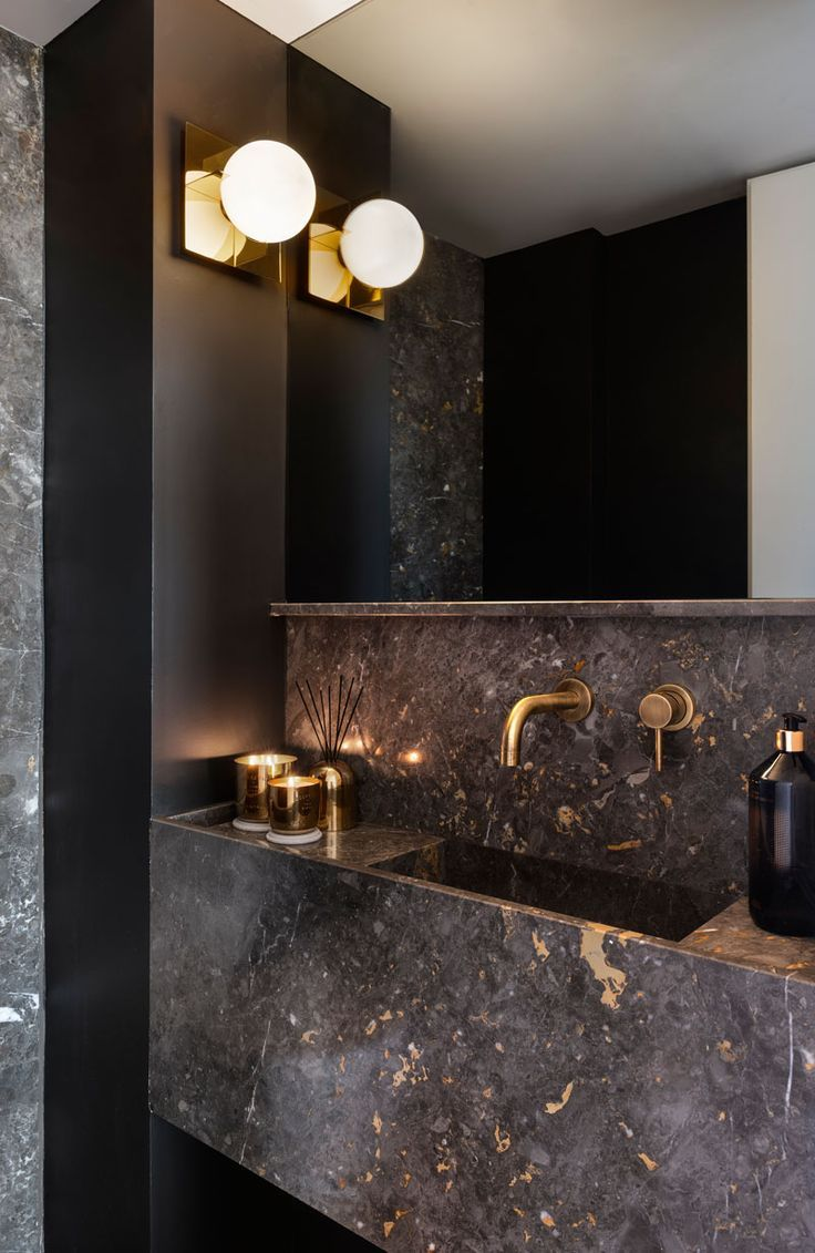 Metallic And Black Accents Help Give This Apartment A Glamorous Interior Modern Powder Rooms Glamorous Interiors Powder Room Design
