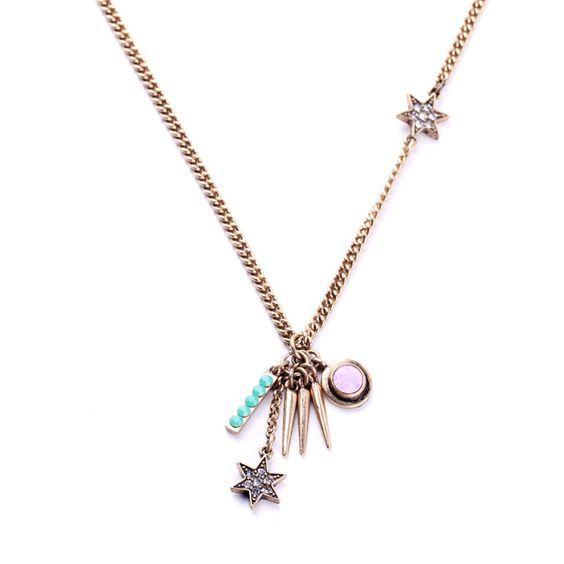 Collier créateur tendance étoiles. Collier créateur orné de pendentifs étoiles monté sur une chaîne bronze de 50cm.