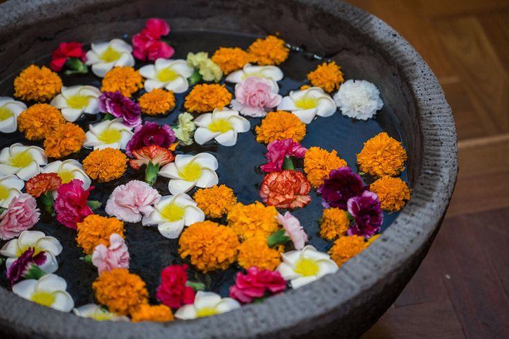 Samantha + Heinz: Vibrant Gaye Holud & Mehndi in Melbourne - A beautiful traditional touch - decorative marigolds and frangipanis in an urn of water - Indian wedding - Indian wedding decor - Sangeet decor #thecrimsonbride