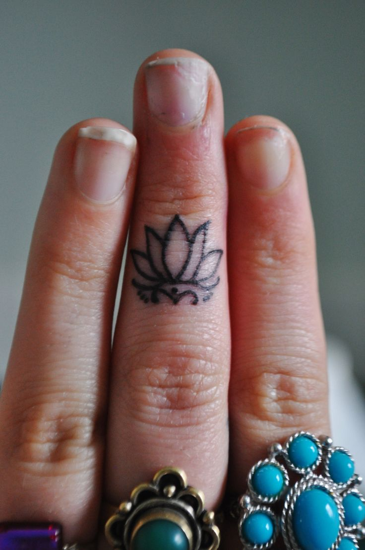 ascendinglotustattoo-vancouver: Little lotus flower. Our shop's logo tattooed on Ashley's finger, done by Rachelle Carroll at Ascending Lotus Tattoo Vancouver, WA