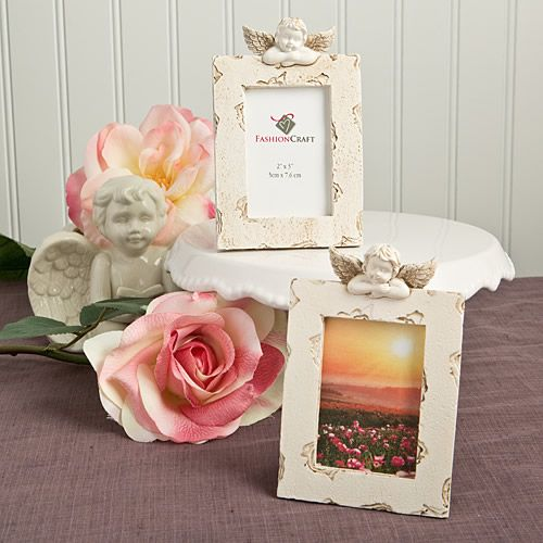 treat yourself to pure romance with these cherub themed place card holderphoto frames