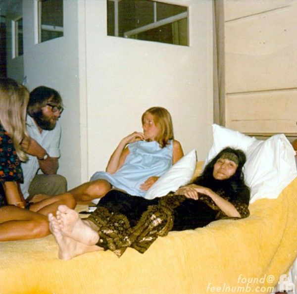 """Photo of Yoko, Linda McCartney, Patti Boyd and Mal Evans lounging in the """"Studio Bed"""" at Abbey Road. Lennon never intended to attend the start of The Beatles """"Abbey Road"""" recording sessions on July 1 but his car crash with Yoko and Julian further delayed his return to London. Upon arrival Lennon arranged for a double bed to be delivered to the studio so he could keep a close eye on Yoko's well-being. Photo by John Lennon 1969"""