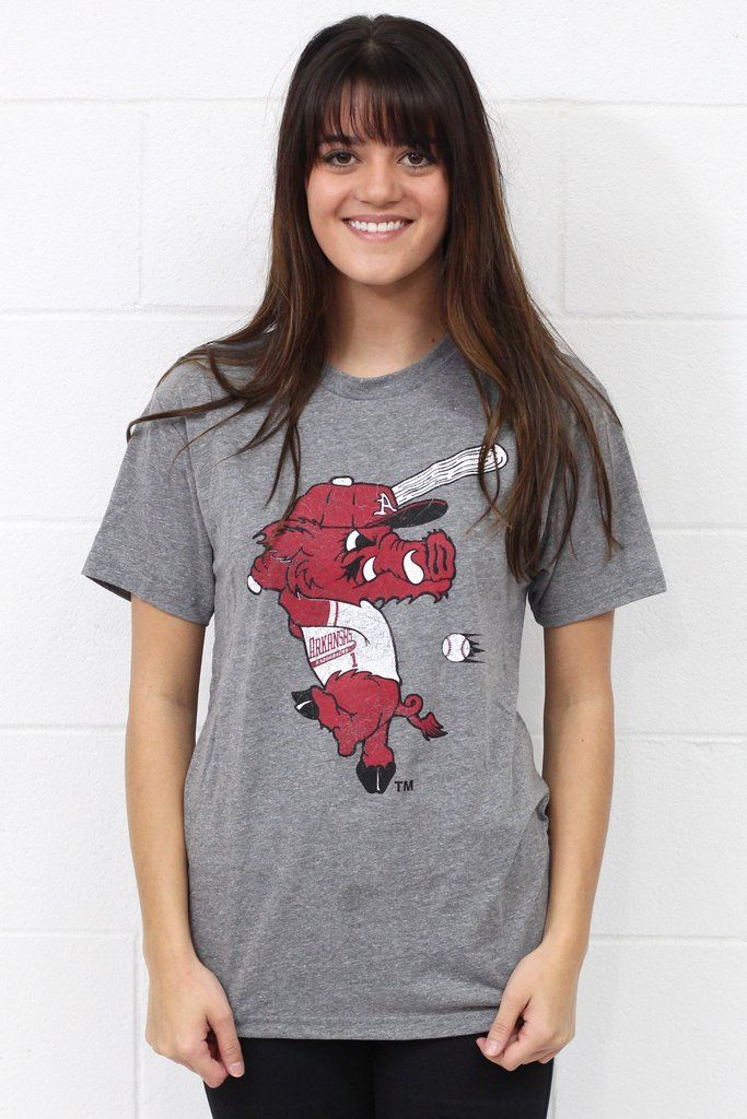 "Short sleeve Arkansas Razorback Baseball tee with Ribby mascot on it. On next level brand short sleeve in heather grey. Fits slightly more fitted than regular t-shirt. Super soft to the touch. Model is 5'9"" pant size 2 wearing size small.S(0-4) M(6-8) L(10-12) XL(14) 2XL(16) 50% Polyester, 25% Cotton, 25% Rayon. #baseball #arkansas #razorbacks"