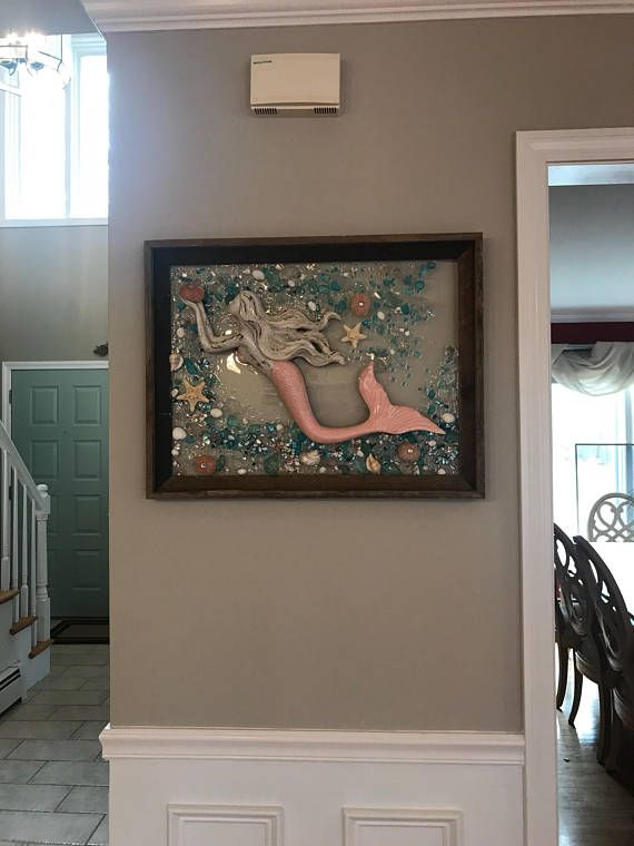 This is a handmade, one of a kind, sea glass/beach glass art piece. The large frame is made from barnwood. Please Keep in mind with barnwood frames- they are made from real barns so some wood has rusted nail holes, and imperfections that only add to their charm. The photo represents the