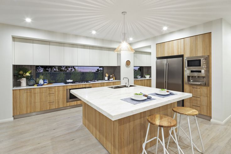 Consider using #Corian as an alternative material for your island benchtop. #kitchendesigns, #islandbench, #MojoHomes, #HomeworldKellyville