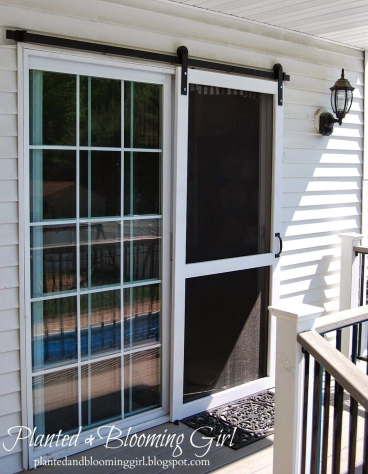 Planted and blooming girl sliding screen door for French doors back porch
