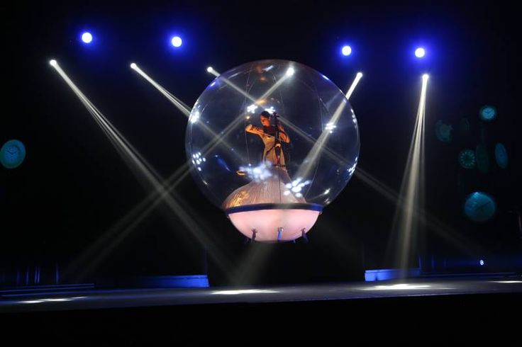 "The Bubble, Cape Town/Johannesburg, South Africa. The delightful result is a clear, glass­like luminescent sphere which bathes the performer in light attached to a glowing stage base. The ""Bubble"", when placed centrally as a focal point, is able to command considerable attention within large venues."