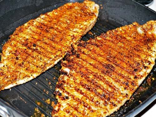Terry's simple Cajun fish recipe:  Ingredients  Chili Powder   1 teaspoon cayenne pepper  1 teaspoon ground cumin  ... Hand ground (coarse) black pepper  ... 1 teaspoon onion salt  Non stick cooking spray  Fish fillets  Electric grill (like a George Foreman)