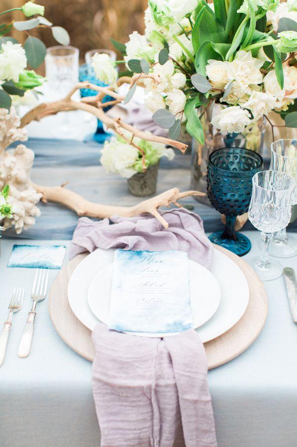 Beachy blue wedding tablescape: http://www.stylemepretty.com/2016/03/29/a-seaside-elegance-styled-wedding-shoot/   Photography: Photos By Sarah Beth - http://www.photosbysarahbeth.com/