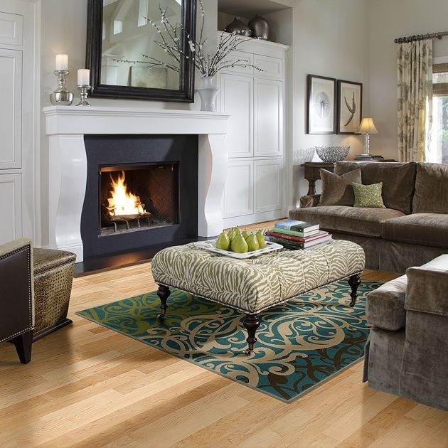 This Shaw Living Area Rug Atop A Hardwood Floor Adds Warmth To The Room And Ottoman Extra Comfort