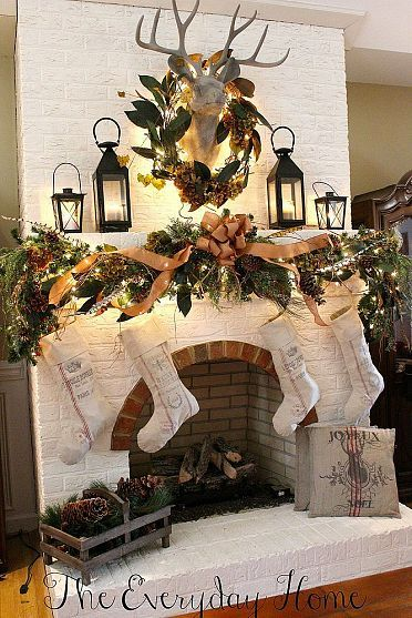 Great over the mantel decoration for the holidays! Christmas mantel and stockings with a charming wreath over a deer head