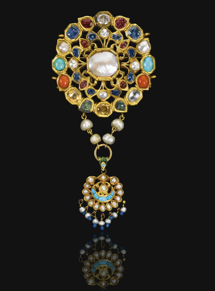 A gem-set gold navratna pendant, Mughal, 19th century   of openwork, floral design with a central mother-of-pearl medallion surrounded by colourful gemstones, including turquoise, moonstone, seed pearl, sapphire, coral, beryl, quartz, ruby, polychrome enamel to reverse, with associated hanging pendant and later brooch pin 10.5cm. length.