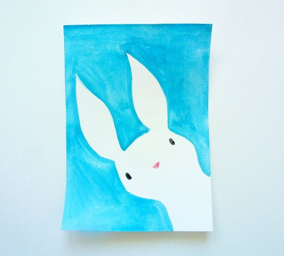 This curious little bunny is peeking around the corner. The original watercolor illustration features a cute white bunny on a bright blue background.  The one of a kind painting would look great in a childs bedroom or as nursery decor. Give the original artwork as a baby shower present, hang it up as Easter or spring decor in your home, or use it to brighten up your work space.  The hand painted watercolour illustration is an original, one of a kind artwork. The paper is acid-free, lightly…