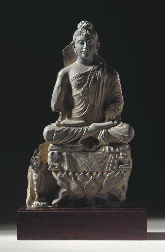 A Gray Schist Figure of Buddha on Lotus Throne GANDHARA, 2ND/3RD CENTURY
