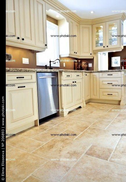 cream cabinets, copper faucet, multi granite