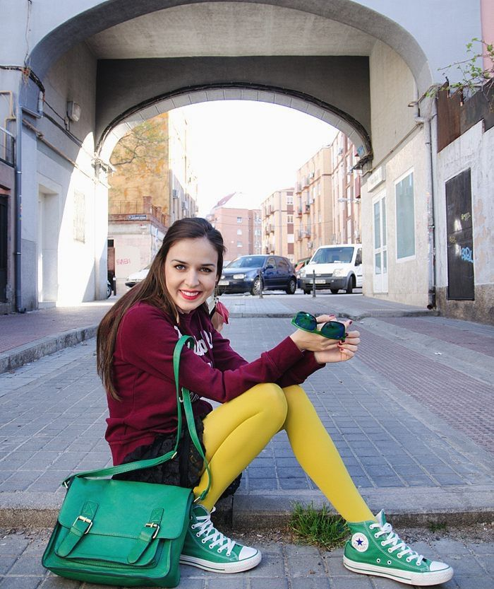 Burgundy sweater, green bag, yellow tights, green converse and big smile