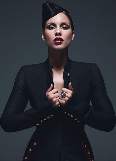 Alexander McQueen's wool jacket. Ellen Christine hat, Versace ring.