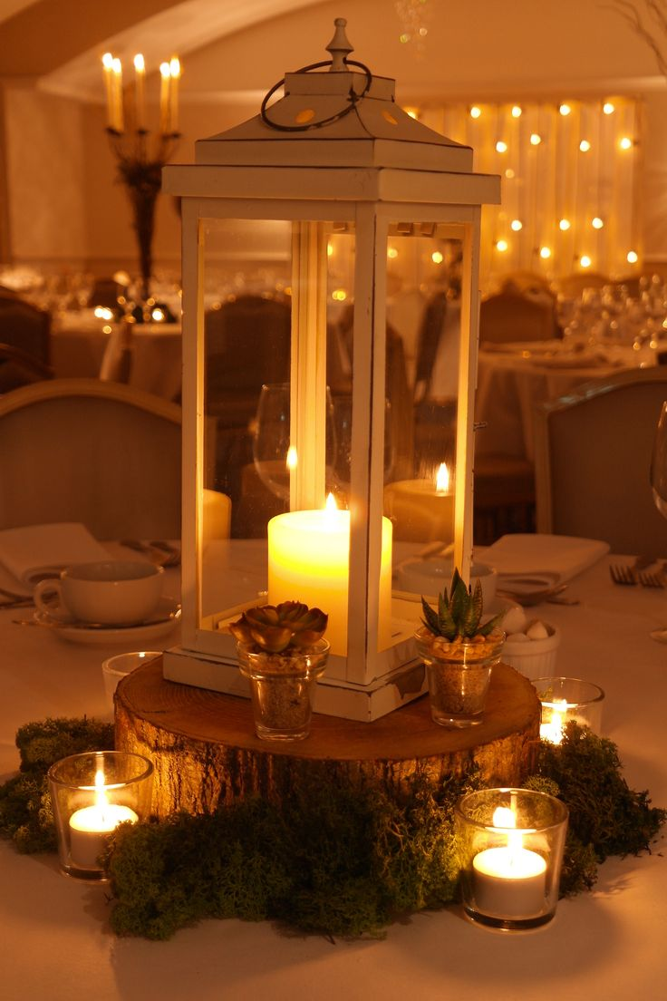Wooden slice table centre with moss succulents votives