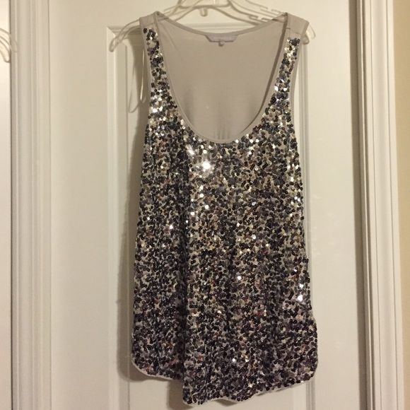 Tank Sequined Top Sequined Tank Top. UK 16 US 14 (label on inside reads US 12) I am a 14/16 and it fits with some room. 100% viscose, color of tank is  very light grey. Red Hering Tops Tank Tops
