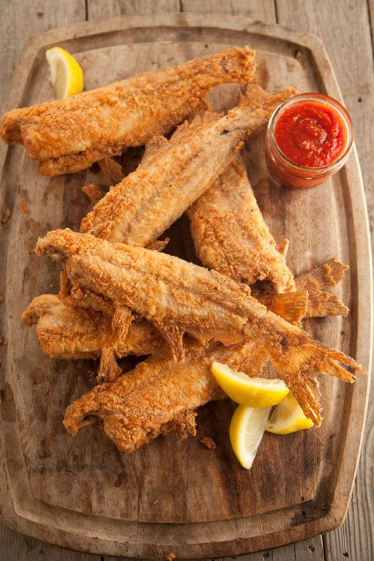 Southern Fried Catfish 2 cups corn meal 1/2 cup all purpose flour crab boil seasoning (recommended: Old Bay) salt 8   (5 to 6-ounce) catfish fillets, skin removed Buttermilk to dip Oil, for frying.