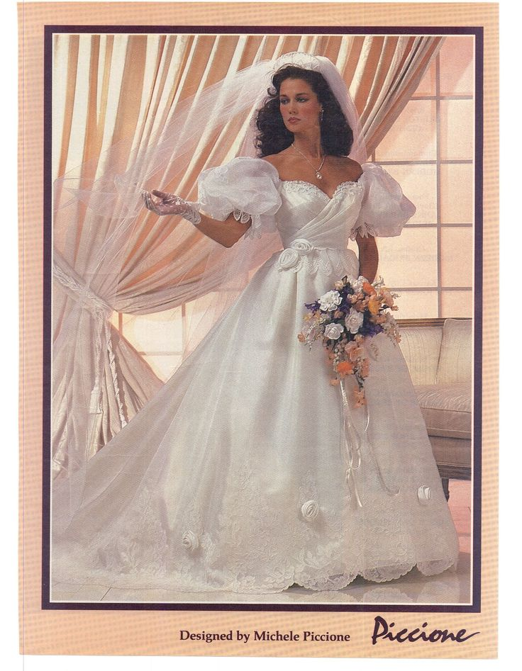 """Modern Bride Feb/Mar 1984.  I love this dress.  It is so frilly, girly, and completely impractical..  I woudl feel like a fairy (sissy) princess in this gown.Matched with a pair of 5"""" white pumps, garter belt and stockings, and lacy white panties I woudl be in heaven!"""