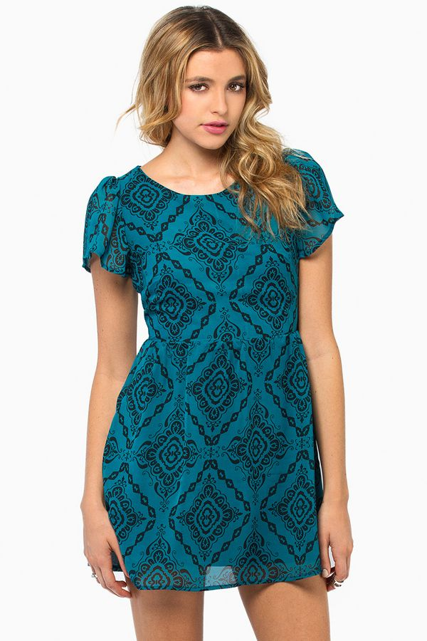 Teal patterned dress.