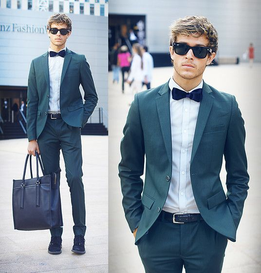 Adam G at Mercedes Benz Fashion Week, in Topman Suit, velvet bowtie by zara,  bag by Coach