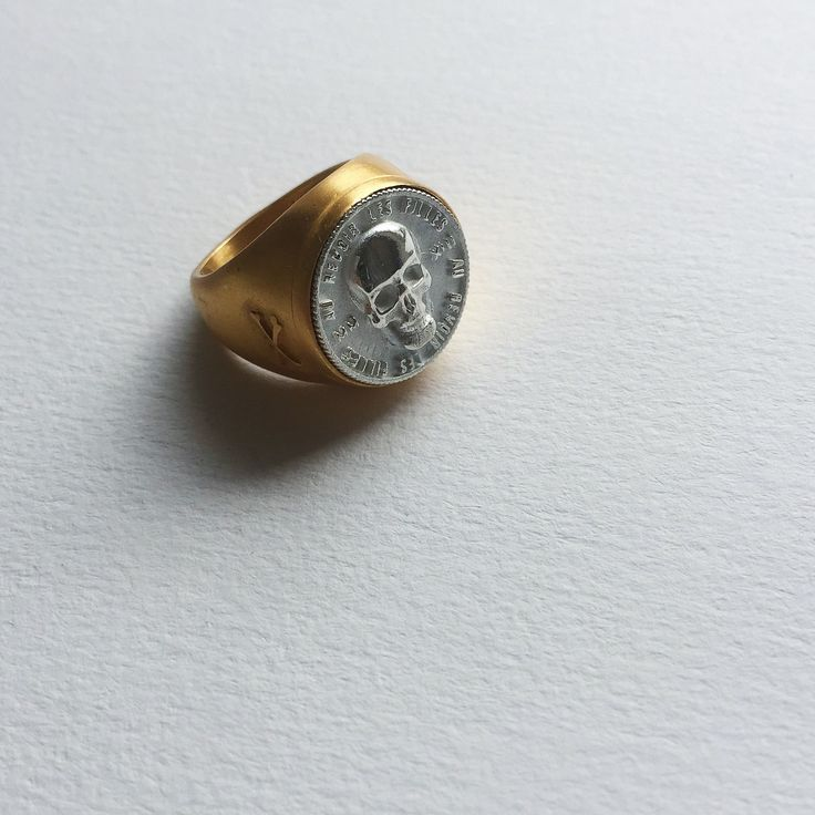 Gold skull signet ring with silver coin - SHOP NOW via website link | In love with a malevolent kind of beauty... Eternal signet skull ring | Finely crafted in sterling silver | Au Revoir Les Filles