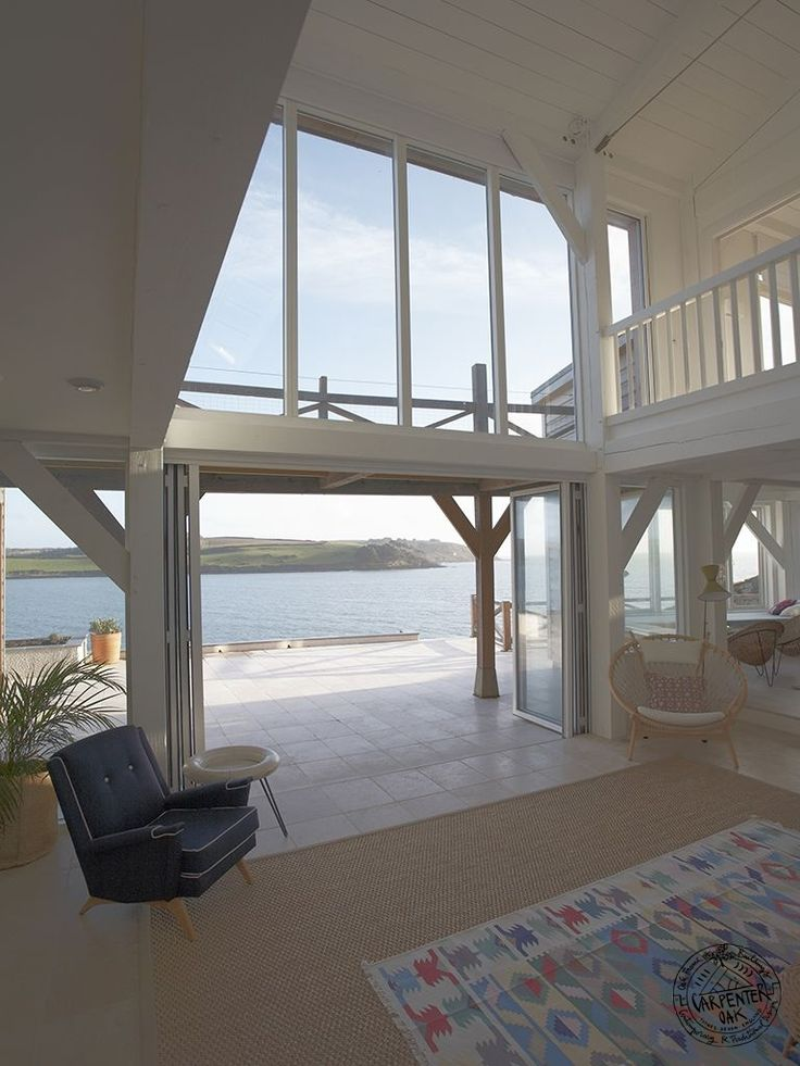 white painted timber frame with st mawes sea views in new build house by carpenter oak house garden designbuild