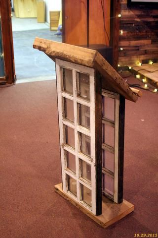 Old windows were used to construct this speaker's podium