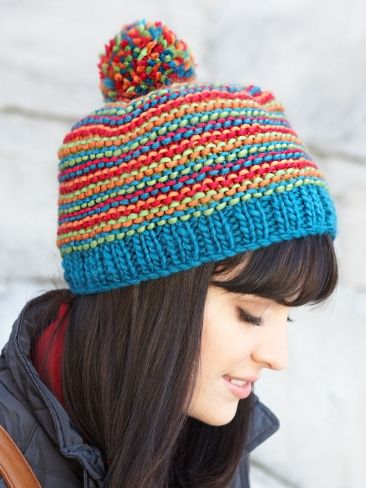 Free Pattern - Four shades of Patons Classic Wool Roving interplay to make this #knit hat a cheery addition to your winter wardrobe.