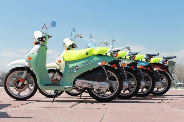 Four Kymco People 50 scooters parked in a row in Denver. A portion of the fleet of ScooTours Denver.