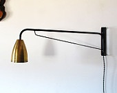 "Black with brass ""potence"" style lamp 48"". $365.00, via Etsy."