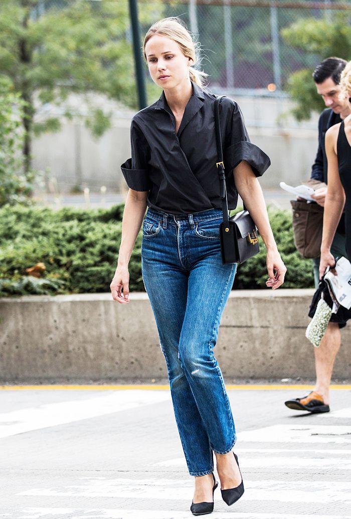 Black top, jeans, and black heels