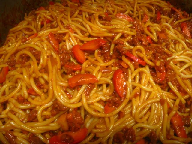Jollibee Filipino spaghetti  Okay, this recipe seems kind of weird if you're not used to it, but it's really good!  Sweet and spicy, and we like it with sliced Chinese sausage and sliced carrots added to it too.  Mmmmm!!!!  :9