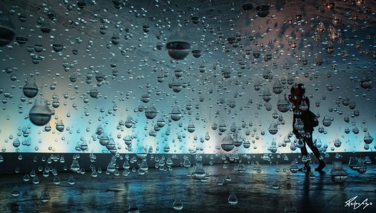 Shot taken inside an Installation In Rio de Janeiro, called Lágrimas de São Pedro (St. Peters Tears). Vinícius S.A., an amazing, young brazilian artist hung thousands of lightbulbs filled with water in this expo room. the idea was to make it possible for people to be inside the rain, in the lapse of time in which the drops of water falls, yet doesnt touch. it is frozen in time, as is the photography itself: both have way more in common than it seems.