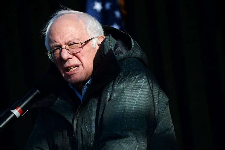 """Sen. Bernie Sanders stands on stage during the """"Our First Stand: Save Health Care"""" rally with Sen. Bernie Sanders, members of the Michigan congressional delegation and local elected officials at Macomb Community College on January 15, 2017 in Warren, Michigan. Photo: Rachel Woolf, Getty Images"""