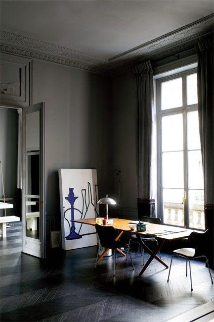 Parisian apartment, Arne Jacobsen chairs around a Hans Wegner table. Photo by Richard Power