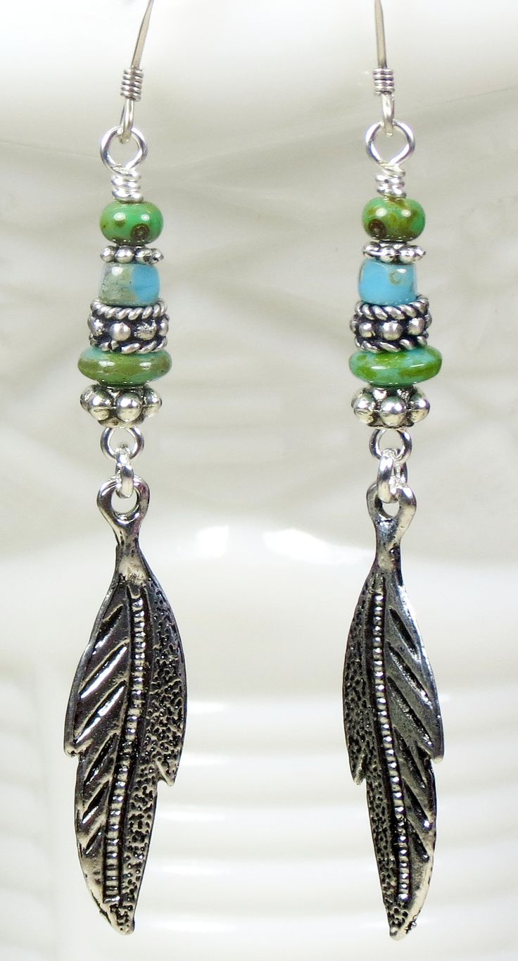Rustic Turquoise and green glass beaded earrings with feather dangle, Southwestern Boho Gypsy Bohemian inspired jewelry. Get your pair today. Visit CharmedbyBonnie