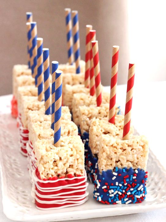 Time-saving #RiceKrispiesTreats made with pre-made Rice Krispies Treats + Wilton candy melts + paper straws + sprinkles! // LifeLoveAndSugar.com- #Patriotic #July4