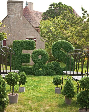 Amazing faux-boxwood letters make a big statement as ceremony markers