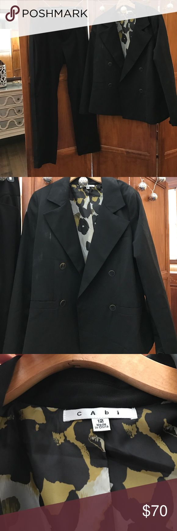 CABI black suit jacket 12/ pant 10 Beautiful 2 piece suit by CABI. Blazer is a double breasted look with a shine to fabric. Pants are slim tuxedo pants with black tux stripe down side. Jacket worn one time, pants never worn. CAbi Other