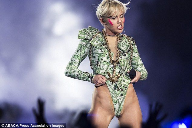 Hacked: Miley Cyrus is the latest celebrity to have naked snaps of her stolen and posted o...